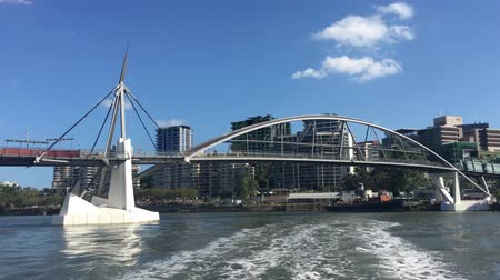 Ferry sailing under Goodwill Bridge and Queensland Maritime Museum as view from a ferry sailing over Brisbane river in Brisbane Queensland Australia Стоковые видеозаписи