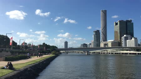 Urban landscape view of Brisbane city downtown skyline and Southbank Parkland in Queensland Australia Stock mozgókép