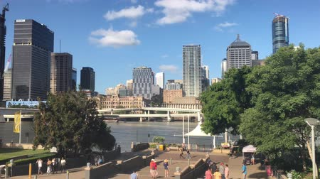 Urban landscape view of Brisbane city downtown skyline as view from Brisbane river Southbank in Queensland Australia Стоковые видеозаписи