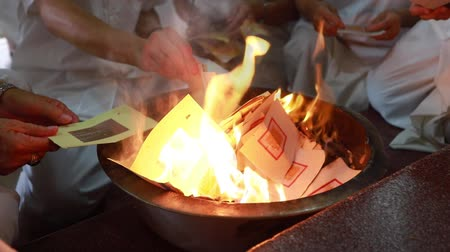 bem aventurança : In funeral ceremony, a lot of people in white cloth burning paper for dead person, its chinese belief. Set paper on fire for praying.