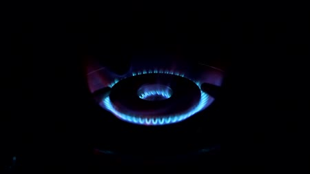 gas burner flame : Open portable gas stove to set fire up, blue flame with some orange in the dark. Look from side Stock Footage