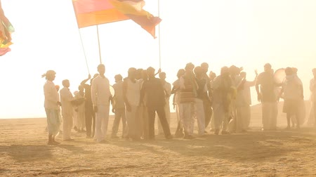 People with Flag at desert