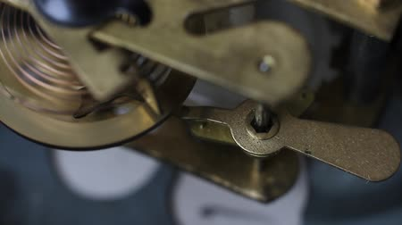 forever : Old vintage clock working, closeup shot with soft focus. Close up of a internal clock mechanism. Vintage Watch Gears Movement Macro. Stock Footage