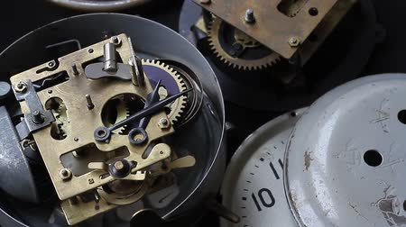 belső : Old vintage clock mechanism working, closeup shot with soft focus. Close up of a internal clock mechanism. Vintage Watch Gears Movement Macro.