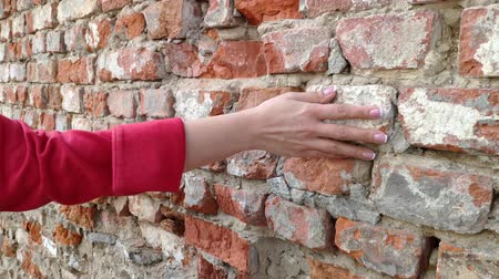 manikür : 4K Womans hand moving over old brick wall. Sliding along. Sensual touching. Hard stone surface. Stok Video
