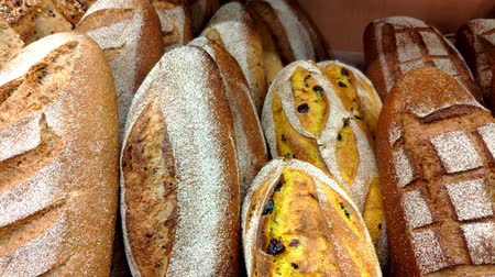 sugar loaf : Bread, buns and other bakery products of golden color on store shelves in motio.