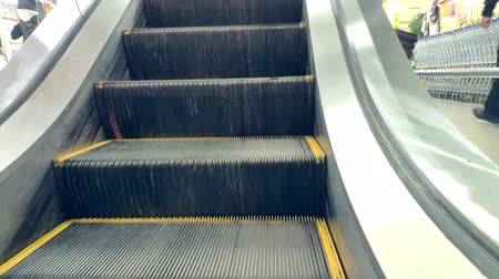 escalera : Closeup of an empty escalator moving up in an mall Stock Footage