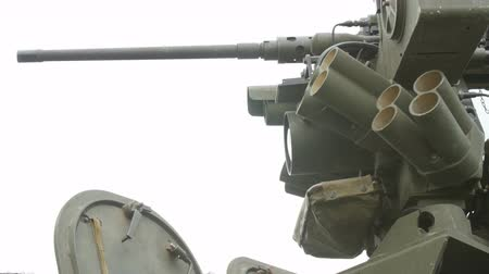operational system : Close up view of the turret, armaments and gun of an operational military armored tank vehicle.