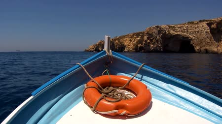 vista frontal : Front view boat with lifebuoy,floating on blue Mediterranean Sea.