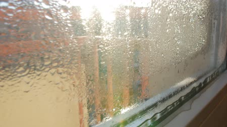 fogged : fogged, frosted window glass, close-up slider movement