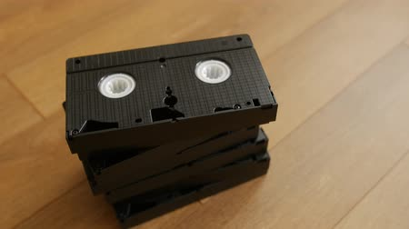 casette : Stack of VHS video tape cassette over wooden background, top view, close up.