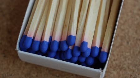rotational : Matches with blue brimstone rotating, close up video. Slow motion. Stock Footage
