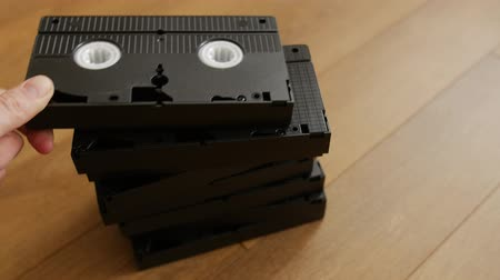 videocassette : Stack of video tape cassette over wooden background, top view, close up.