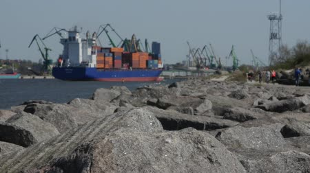klaipeda : A large loaded with containers cargo ship enters the port of Klaipeda. Lithuania.