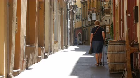 europe population : NICE, FRANCE - OCTOBER, 2016: People are walking in the narrow streets of the old city.