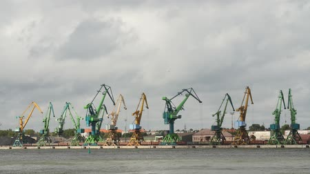 klaipeda : KLAIPEDA, LITHUANIA - AUGUST, 5, 2017 Port crane in time lapse cloudy day