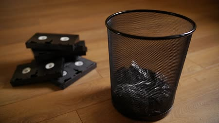 videocassette : Thrown out useless cassettes. Obsolete Video Format. Slow motion. Stock Footage