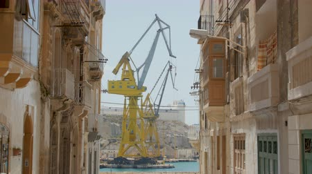 docklands : Valletta Malta - July 6 2016: Huge Ship yard crain in Malta. Valletta has a deep sea port for shipping and massive dry docks for ship yard works.