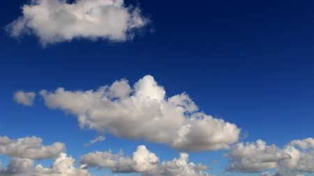 condensed : Beautiful white clouds forming and moving in blue sky