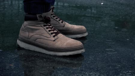 sıçrama : Close-up View of Man in Boots is Waiting in the Rain.