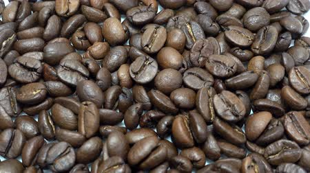brew coffee : Coffee beans background. Close-up of rotating roasted coffee beans. HD video Stock Footage