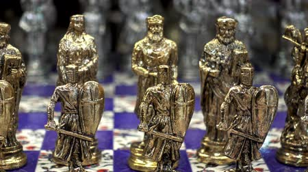 lovagi torna : Golden chess pieces in the shape of ancient soldiers close-up. HD video