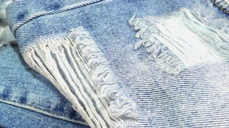 western wear : Blue torn jeans close-up. HD video Stock Footage