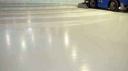 recondition : A special machine for resurfacing ice cleans the surface of the ice rink. HD video
