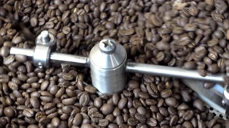 roaster : Close-up of roasting of fresh coffee beans. Coffee roasters machine. HD video Stock Footage