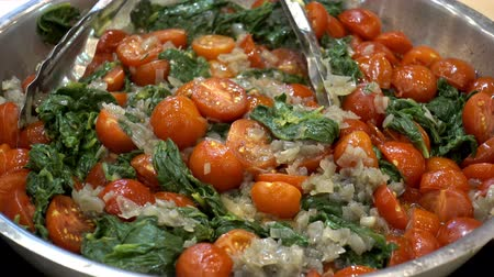 minas gerais : Salad of red ripe tomato and other ingredients in a bowl with tongs. HD video
