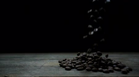Slow motion of coffee beans on a black background. Stock Footage