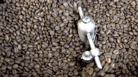 Coffee beans are roasted in the drum machine. HD video