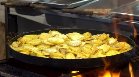 Potato pieces are grilled in a skillet. HD video Stock Footage