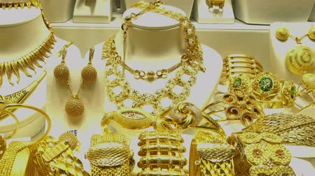 showcase : Piles of gold necklaces, chains and bracelets in oriental jewelry store. HD video Stock Footage