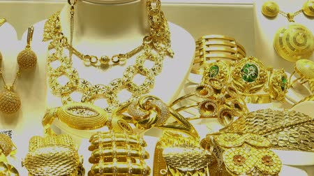 Piles of gold necklaces, chains and bracelets in oriental jewelry store. HD video Stock Footage