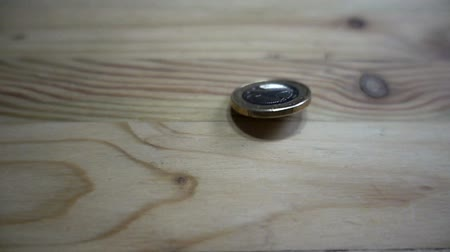 Value of 2 euros on a wooden table