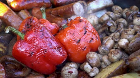 Various vegetables and mushrooms grilled. Appetizing red pepper close-up. Street food. HD video