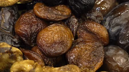meruňka : Dried fruits dried apricots, dates, figs as a background. HD video