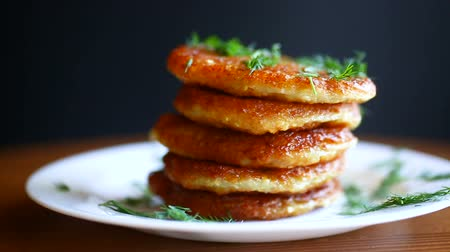 erva doce : potato pancakes with dill in a plate