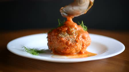 almôndega : meatballs with tomato sauce on the table