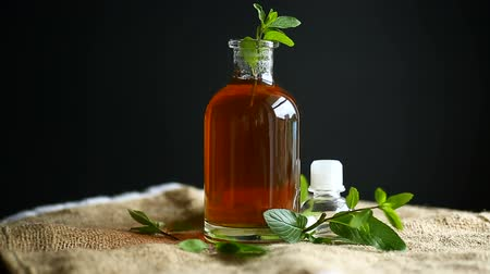 хлорофилл : Mint syrup in a glass bottle Стоковые видеозаписи