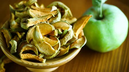 picado : Dried apples in a bowl with a fresh apple Stock Footage