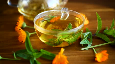 pot marigold : curative fresh hot tea with calendula flowers in a cup