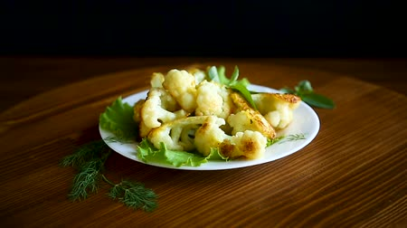garnished : cauliflower fried in batter with greens and Stock Footage