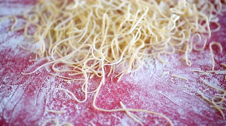 vermicelli : egg homemade dried finely chopped noodles on table Stock Footage