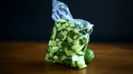 соленья : fresh sliced cucumbers in a vacuum package
