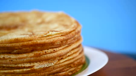 креп : big high stack of thin pancakes in a plate