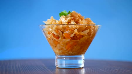 kavurma : stewed cabbage with carrots in a glass bowl
