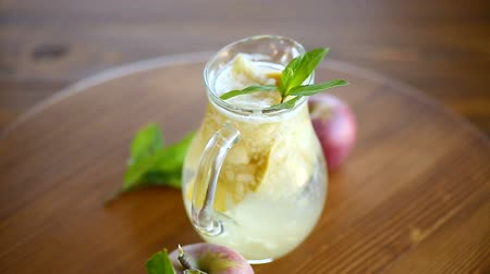 pears : summer sweet cold compote of fresh apples with a sprig of mint