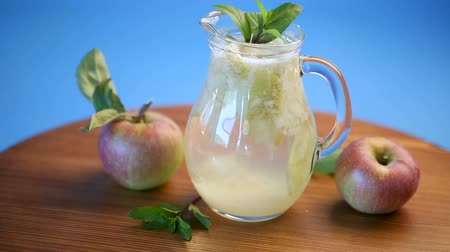 glass pitcher : summer sweet cold compote of fresh apples with a sprig of mint